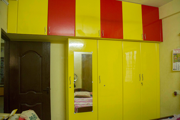 Bedroom Attic Storage Unit & Closet with Mirror Ajith interiors BedroomWardrobes & closets Plywood Yellow