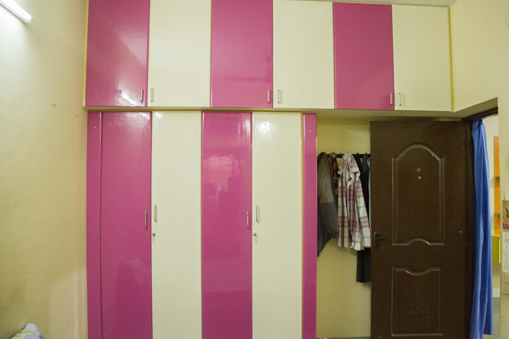 Bedroom Attic Storage Unit & Closet Ajith interiors BedroomWardrobes & closets Plywood Pink