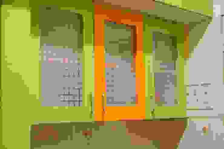 Kitchen cabinet: modern  by Ajith interiors,Modern Glass