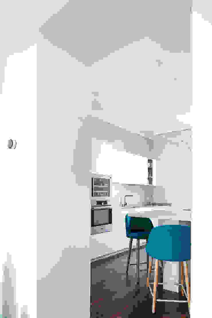 CASA A. di GruppoTre Architetti Minimalista