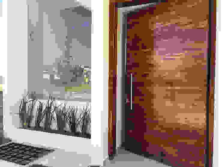 CASA PAROTA Puertas modernas de Planlife Edificaciones Moderno