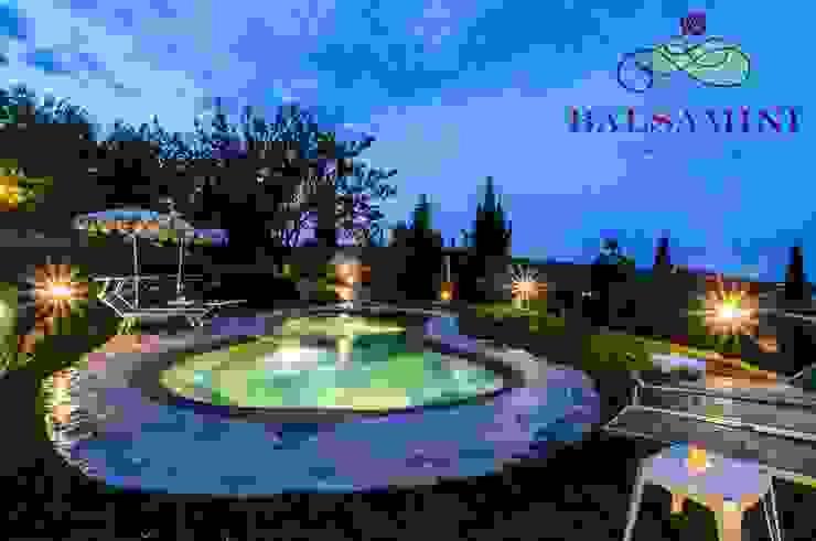 Piscina interrata naturale Balsamini Gardens & Pools Design Giardino con piscina