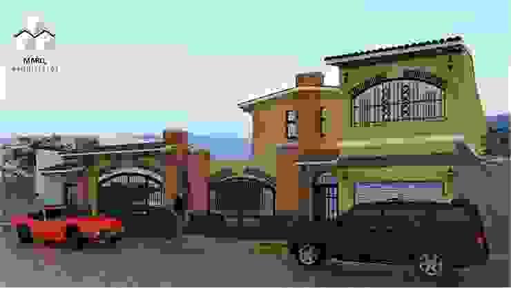 MARQ. Arquitectos. Rustic style house Bricks Orange
