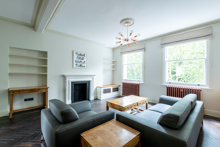 The living room Prestige Architects By Marco Braghiroli Salas de estar modernas