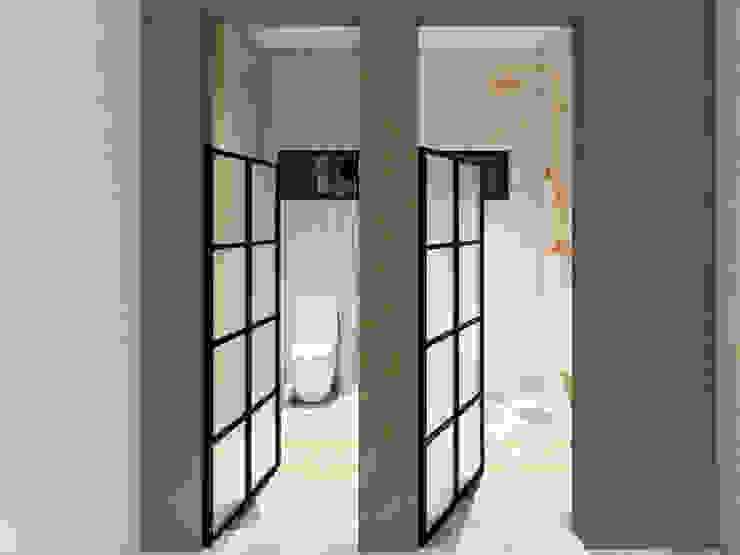 Toilet / Regadera A.DESIGN Baños industriales Blanco