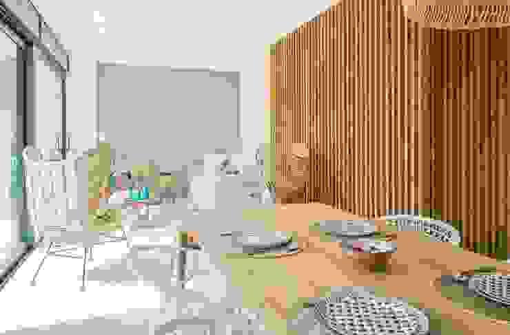 Salón - Comedor de estilo mediterráneo Comedores de estilo mediterráneo de Francisco Pomares Arquitecto / Architect Mediterráneo Madera Acabado en madera