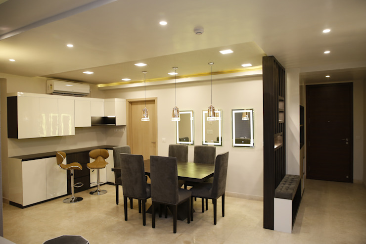 DLF Newtown Heights Kolkata - Dining and Crockery Unit with Built in Bar:  Dining room by Kphomes,Modern
