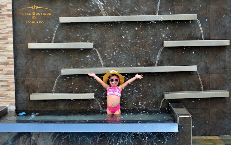 Fuente para área de piscina Piscinas de estilo moderno de Creart Acabados Moderno