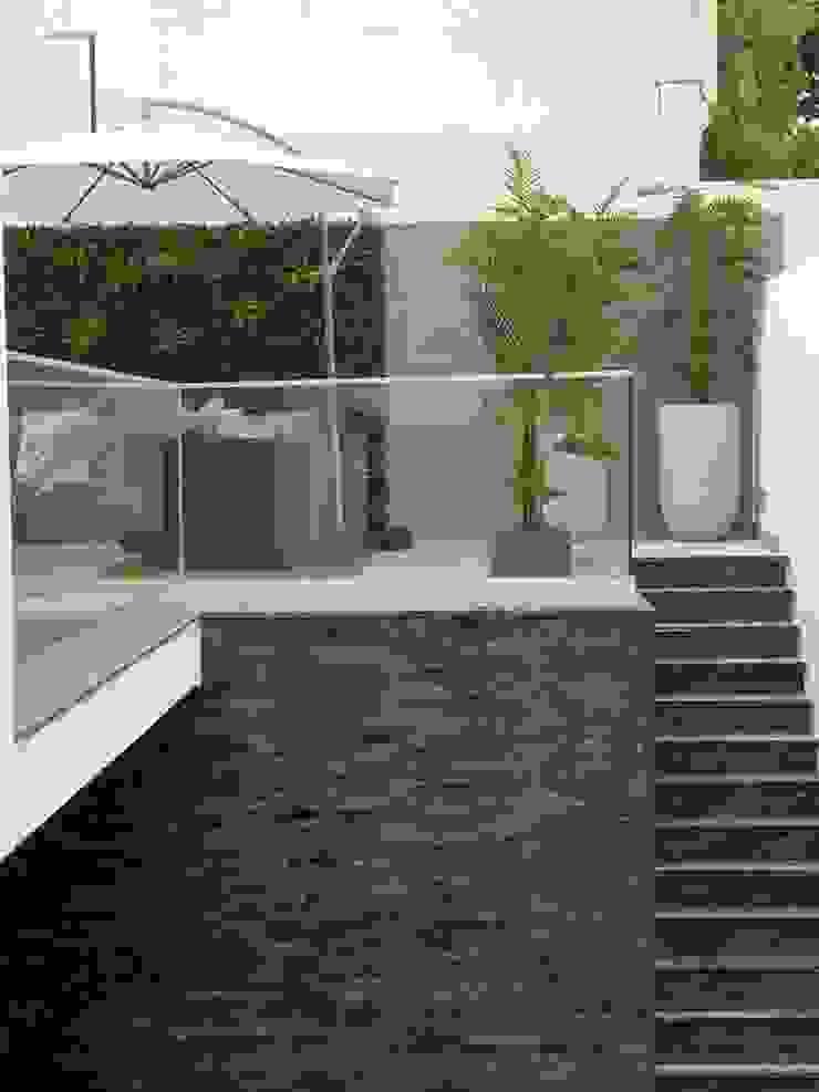 Jardines de estilo tropical de MEA Interior Design Tropical