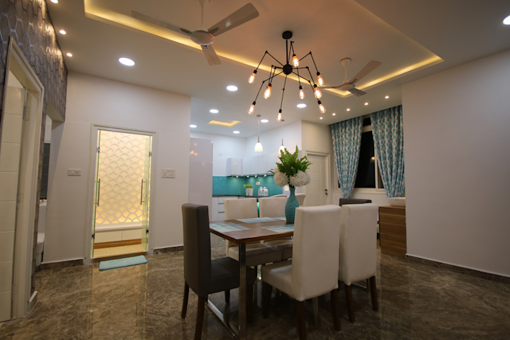 Lighting above Dining Table Unit Modern dining room by Enrich Interiors & Decors Modern