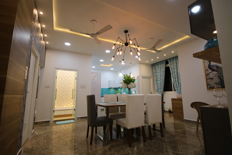 Dining View with open Kitchen Modern dining room by Enrich Interiors & Decors Modern
