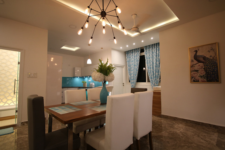Dining with open Modular kitchen and breakfast counter view Modern dining room by Enrich Interiors & Decors Modern