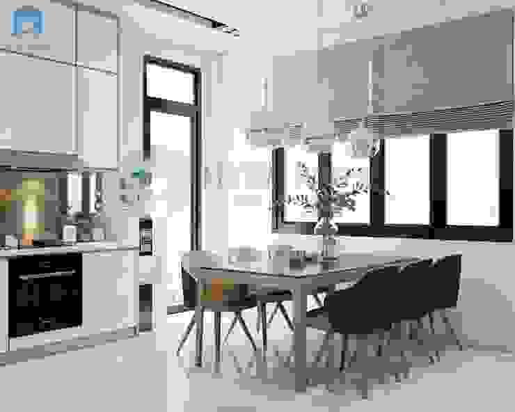 Bộ 6 ghế Minotti kết hợp với bàn ăn gỗ mặt kiếng hình chữ nhật kiểu dáng đơn giản, hiện đại. Đèn trang trí độc đáo ngay khu vực bàn ăn làm cho góc này trở nên nổi bật bất kể ngày hay đêm. Phòng ăn phong cách hiện đại bởi Công ty TNHH Nội Thất Mạnh Hệ Hiện đại Cao su