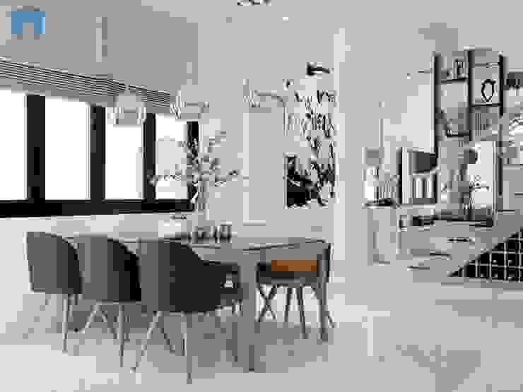 Khoảng không gian kết nối giữa phòng khách và bếp ăn có màu sắc tươi tắn trang nhã Phòng ăn phong cách hiện đại bởi Công ty TNHH Nội Thất Mạnh Hệ Hiện đại Đá hoa cương