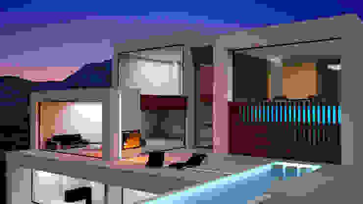 Vista nocturna de la terraza, piscina y fachada. Villa 17 en La Sella. Casas de estilo moderno de Barreres del Mundo Architects. Arquitectos e interioristas en Valencia. Moderno