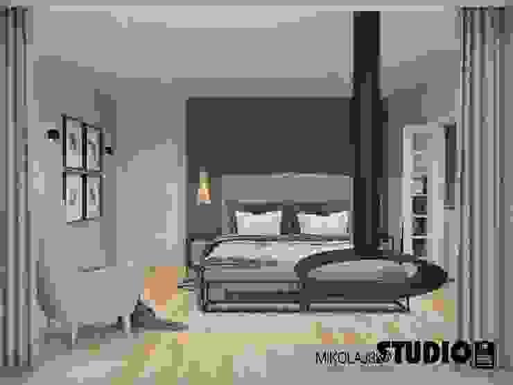 sypialnia z kominkiem Eklektyczna sypialnia od MIKOŁAJSKAstudio Eklektyczny