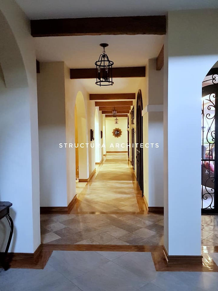Hallway - Protects the house's interiors from direct sunlight Structura Architects Mediterranean corridor, hallway & stairs Tiles Brown