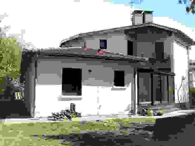 Véranda après travaux Maisons modernes par FARACHE CLAUDE Moderne