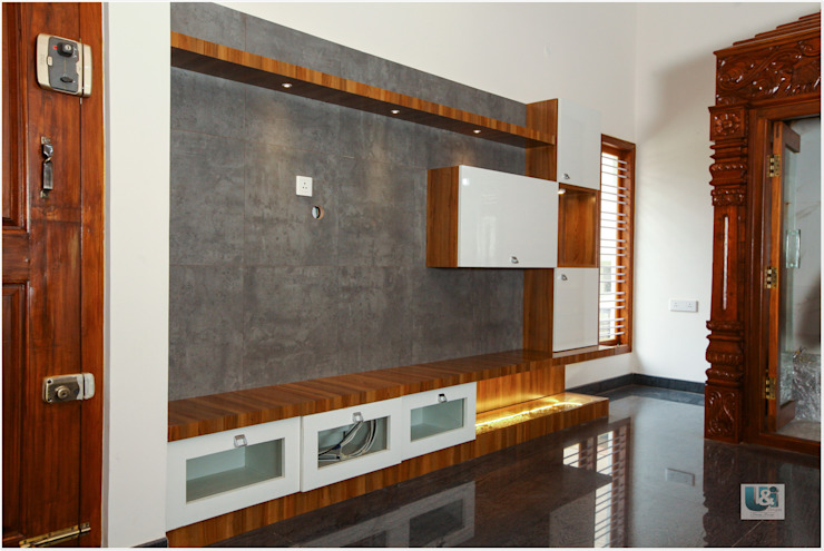 The TV Unit with a pebble tray: modern  by U and I Designs,Modern