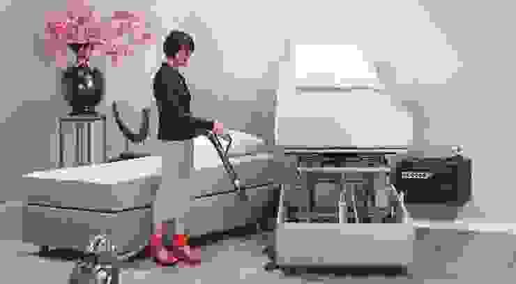 Hoog laag bed: modern  door De Suite, Modern