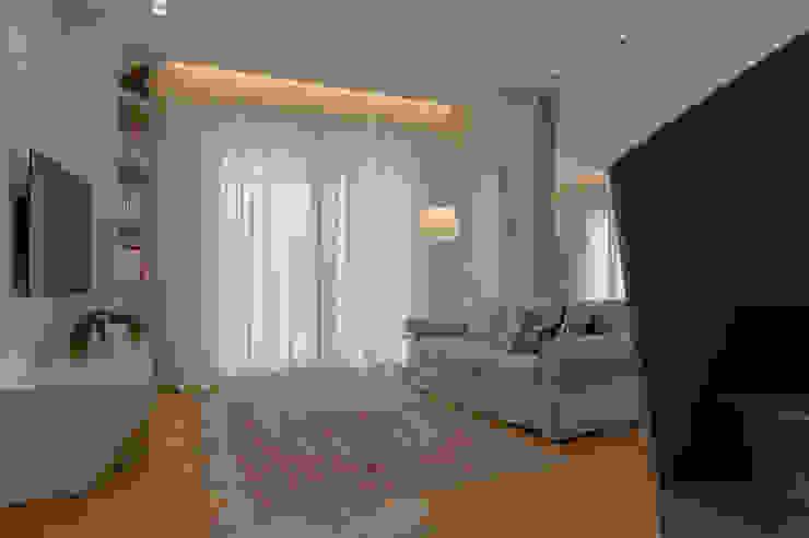 Archifacturing Salas de estilo ecléctico Beige