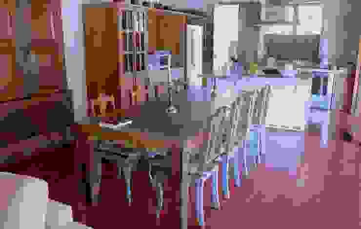Salle à manger rustique par Mazorra Studio Rustique Briques