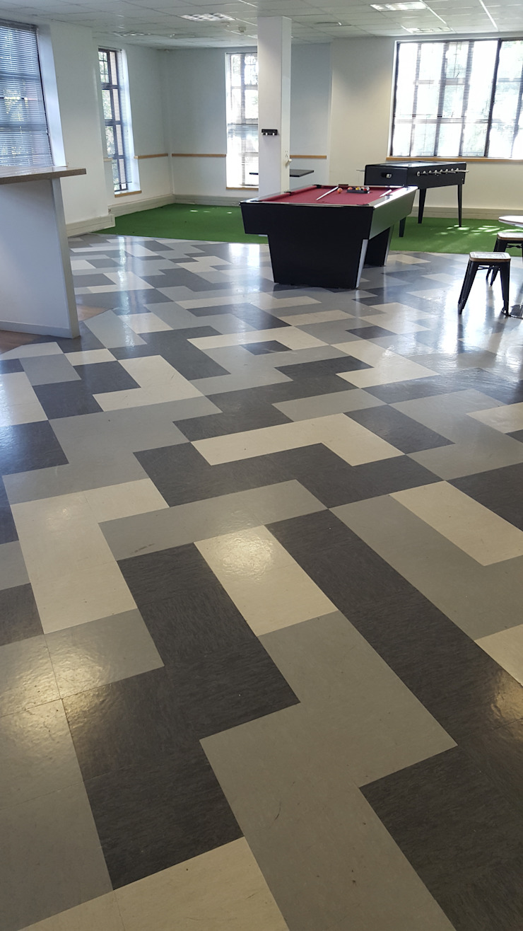 Vinyl Tiles laid in a funky pattern in the Chill Area of the office by Flooring Projects Modern