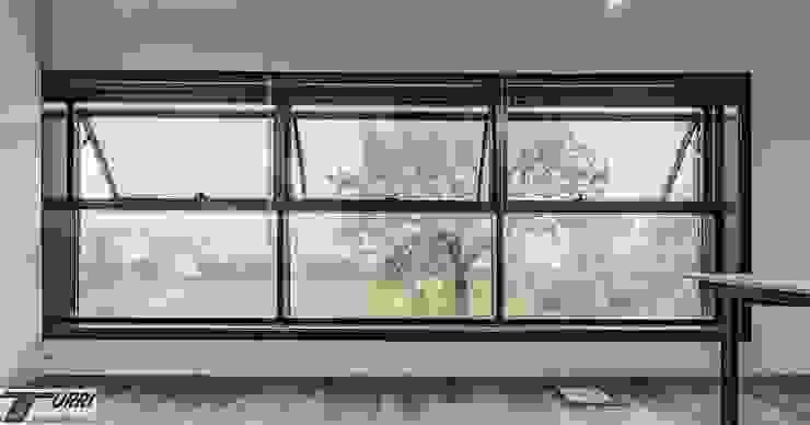 Sistema di facciata continua SL 50 in alluminio a taglio termico Complesso d'uffici in stile industrial di Turri Serramenti Srl Industrial Alluminio / Zinco