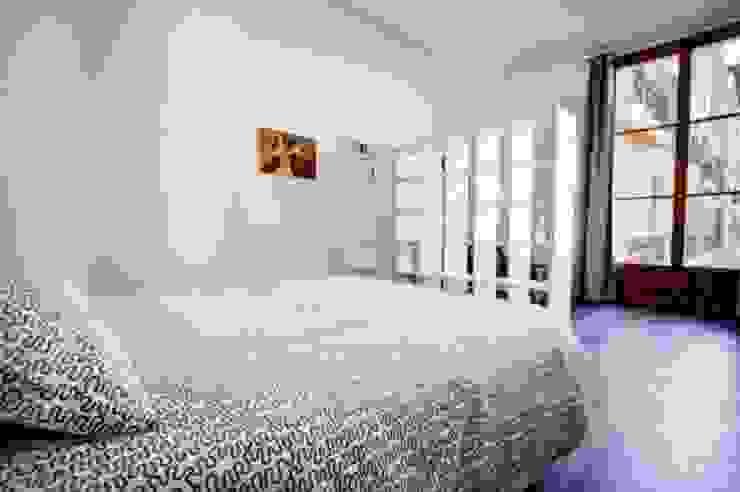 Dormitorio de FOCUS Arquitectura Minimalista