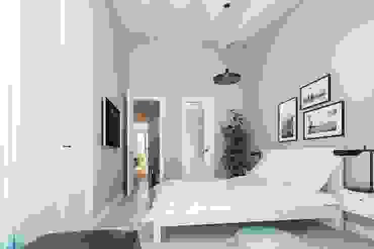 Reforma de moderno ático. Dormitorio FOCUS Arquitectura Cuartos de estilo moderno Beige