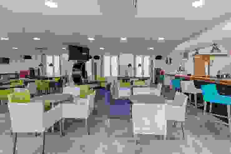 Projecto Decoração Interiores Hostel da Praça Hotéis modernos por Versatilis Inovação Design Moderno
