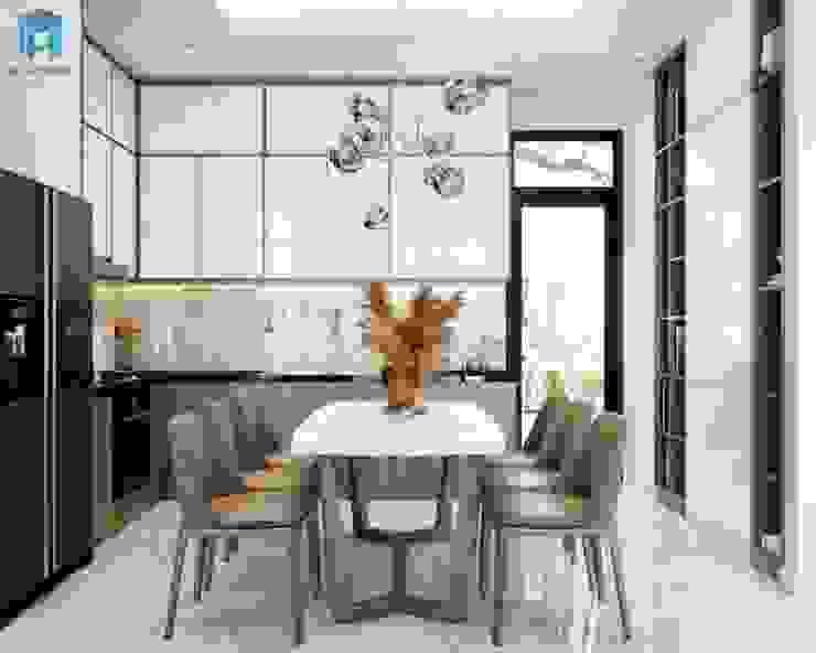 Đèn trần kiểu dáng độc đáo giúp căn bếp sang trọng hơn Phòng ăn phong cách hiện đại bởi Công ty TNHH Nội Thất Mạnh Hệ Hiện đại Đá hoa cương