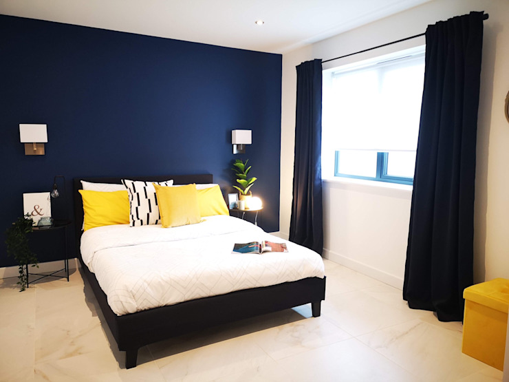 Contrasting navy bedroom by THE FRESH INTERIOR COMPANY Modern Marble