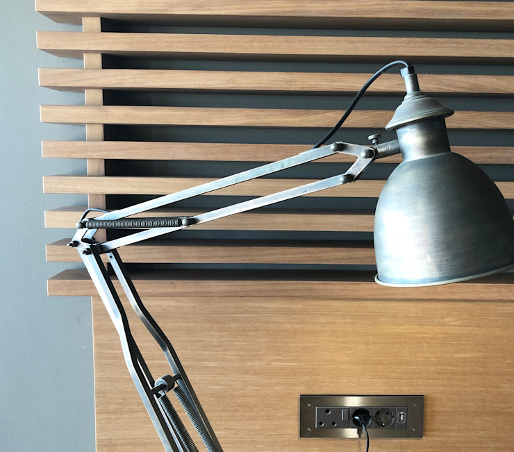 Detail. Solid wood shelving and sleek brushed stainless steel plug point cover plate. by Turquoise
