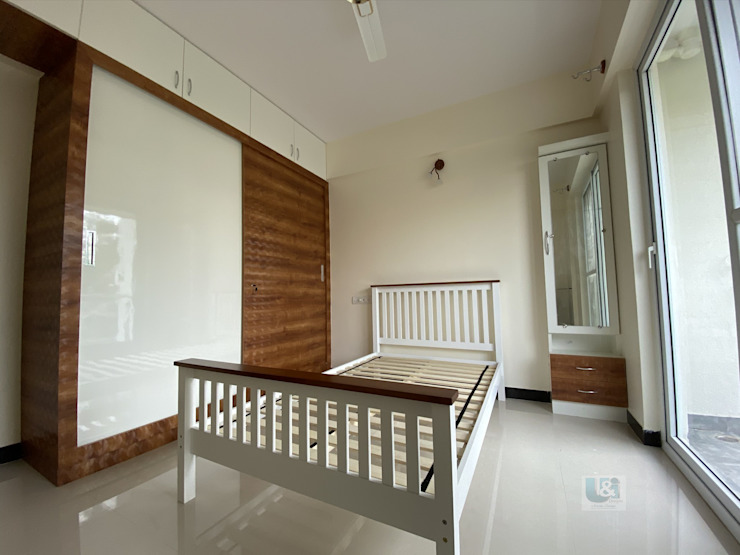 A rather simple & neat Kids Bedroom Modern style bedroom by U and I Designs Modern