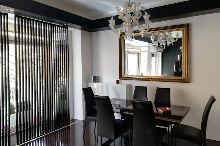 la sala da pranzo Sala da pranzo moderna di Altro_Studio Moderno Vetro
