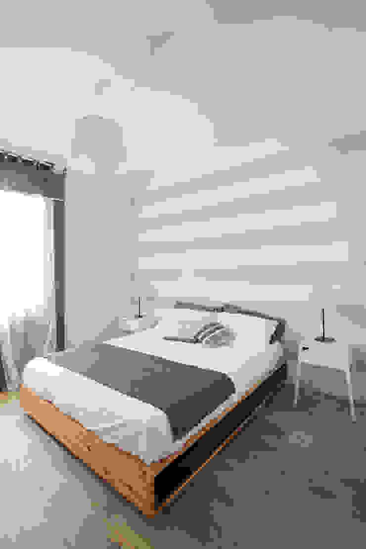 Camera GruppoTre Architetti Camera da letto moderna