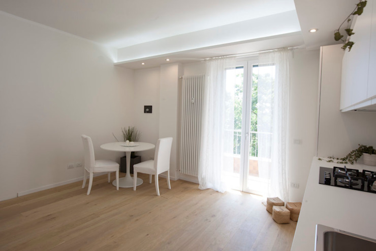 Modern dining room by GruppoTre Architetti Modern Wood Wood effect