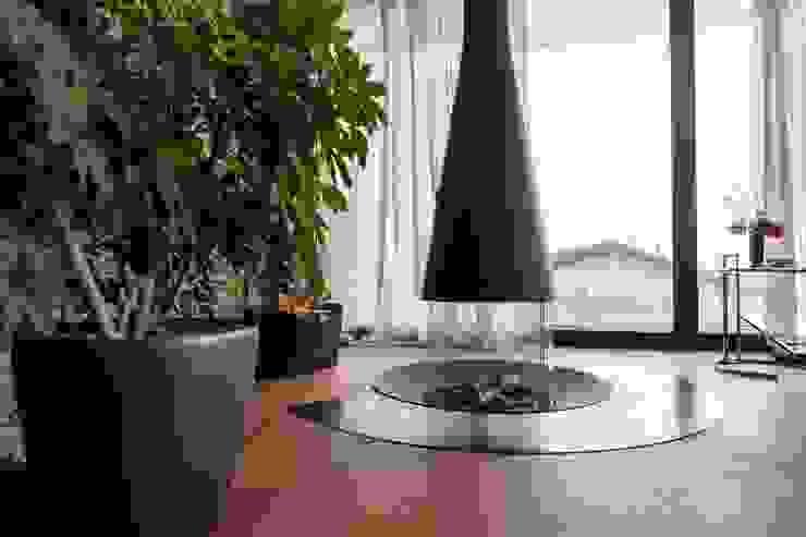 Runder Kamin Avantecture GmbH Moderne Wohnzimmer