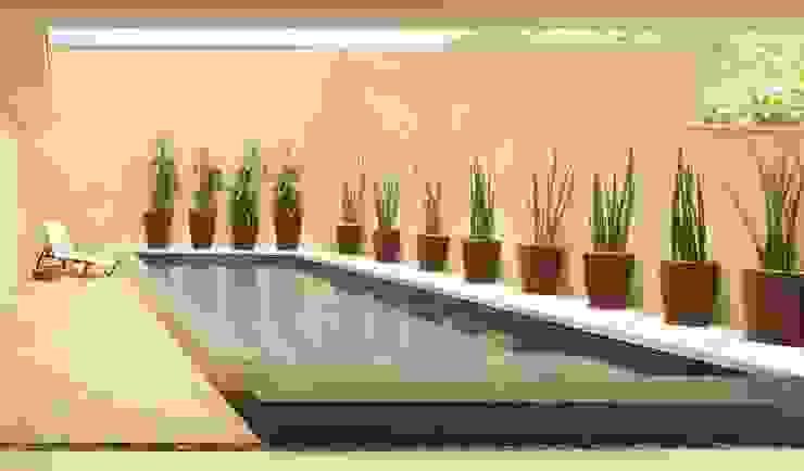 Piscina verde com borda infinita por RAWI Arquitetura + Design Moderno Pedra