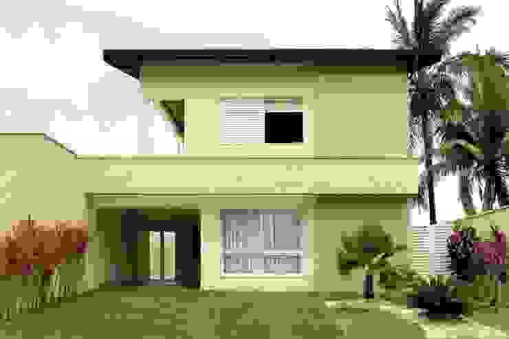 Remodelação da fachada existente RAWI Arquitetura + Design Casas familiares Pedra Bege