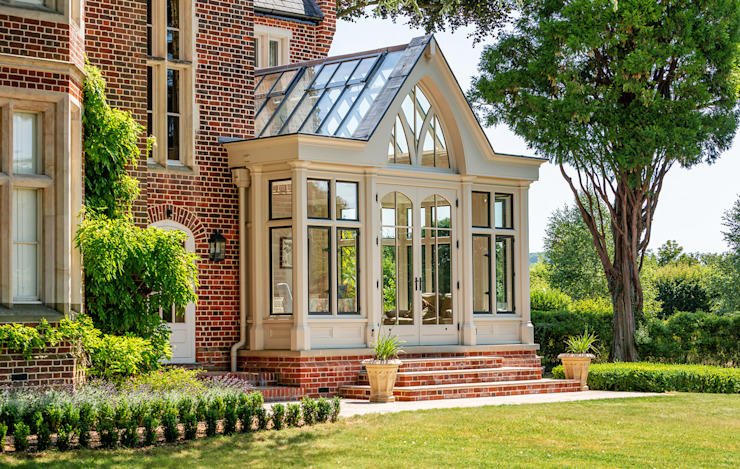 Large bespoke orangery with bronze windows and a tall decorative gable end Vale Garden Houses Classic style conservatory Wood Beige
