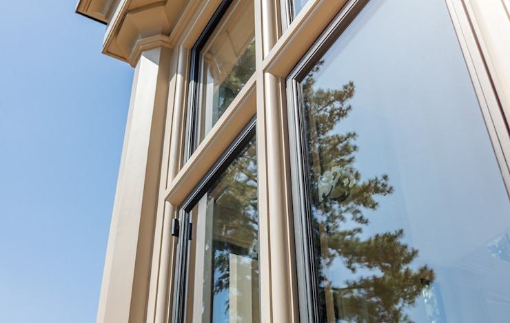 Close up of metal windows in a bespoke orangery Vale Garden Houses Classic style conservatory Wood Beige