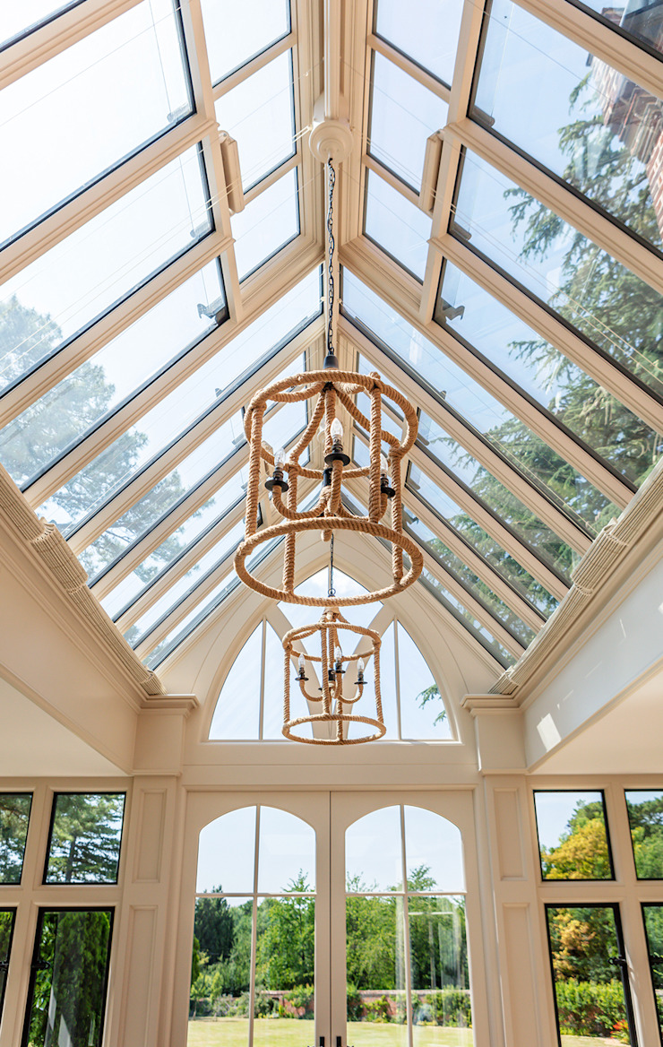 Internal view of a large bespoke orangery designed for dining and relaxing Vale Garden Houses Classic style conservatory Wood Beige
