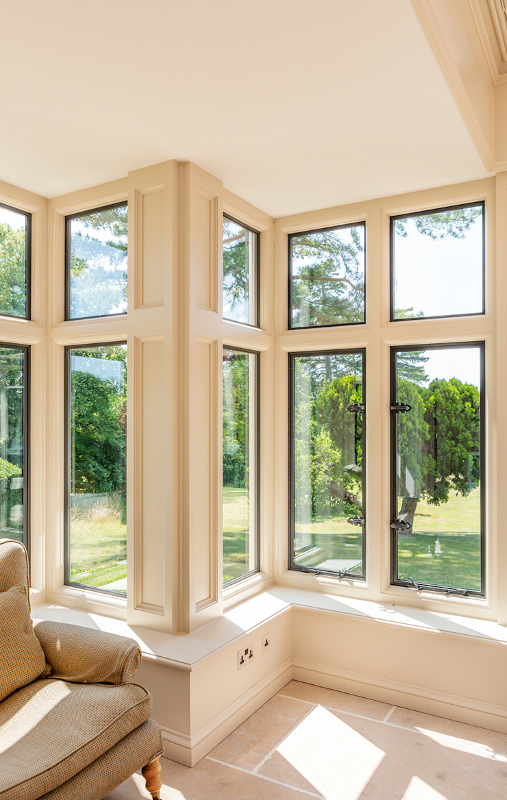 View of metal windows by Bronze Casements in a bespoke orangery Vale Garden Houses Classic style conservatory Wood Beige