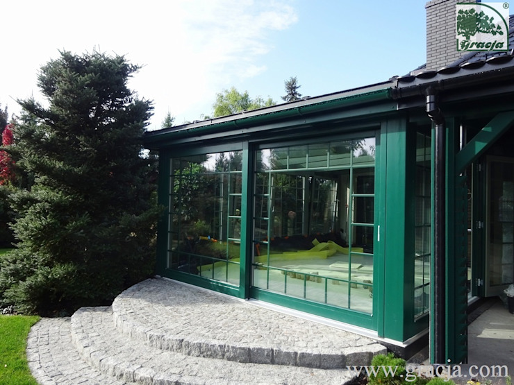 Classic style conservatory by GRACJA SP. Z O.O. Classic Wood Wood effect