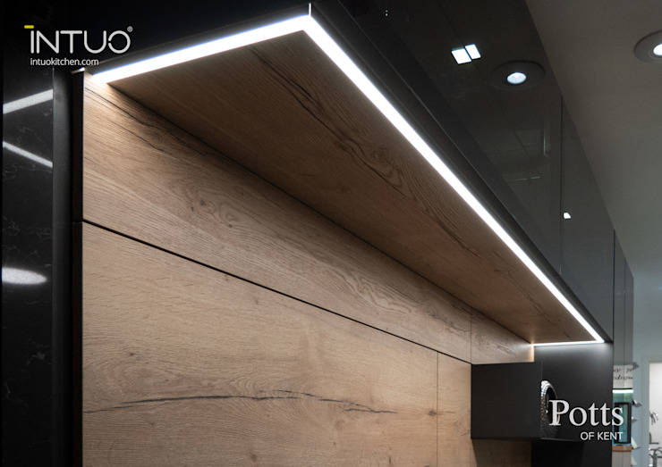 Beautifully lit Intuo glass kitchen Intuo Modern kitchen