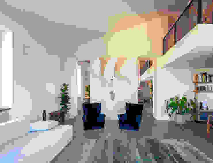 ATTICO TRASTEVERE - Aperture simmetriche verso la grande cucina Leonori Architetti Soggiorno in stile scandinavo
