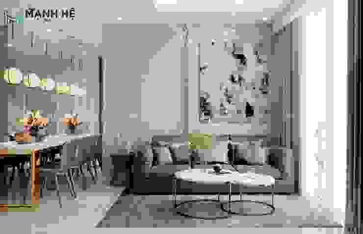 Vách tường sau ghế sofa được bọc simili và đi ron vàng sang trọng bởi Công ty TNHH Nội Thất Mạnh Hệ Hiện đại