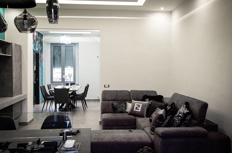 Area Living con Salotto e zona pranzo di Meka Arredamenti Moderno